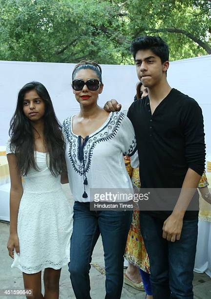 Gauri Khan wife of Bollywood actor Shah Rukh Khan with her son Aryan and daughter Suhana during the inauguration of a bakery shop 'The Brown Box' by...