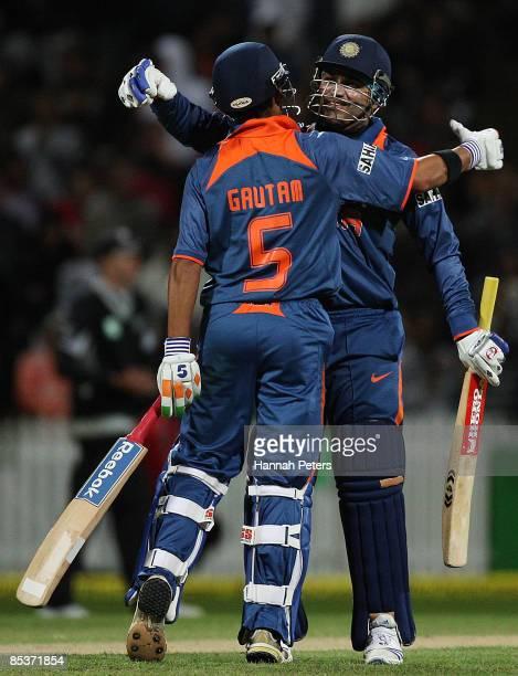 Gautam Gambhir celebrates his 100 run partnership with Virendar Sehwag during the fourth one day international match between the New Zealand Black...