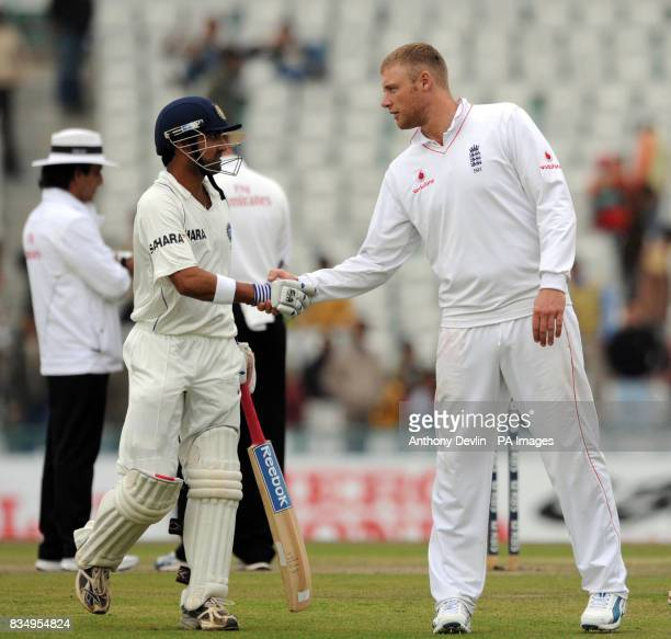 Gautam Gambhir is congratulated on his century by Andrew Flintoff as the players leave the field due to bad light during the first day of the second...