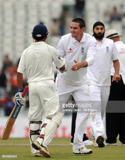 Gautam Gambhir is congratulated on his century by Kevin Pietersen as the players leave the field due to bad light during the first day of the second...