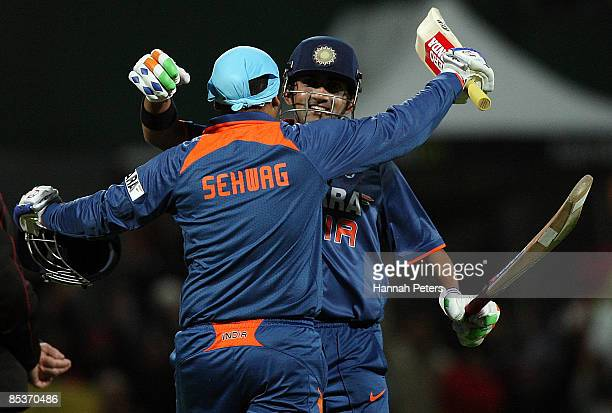 Gautam Gambhir of India congratulates Virendar Sehwag after his century during the fourth one day international match between the New Zealand Black...