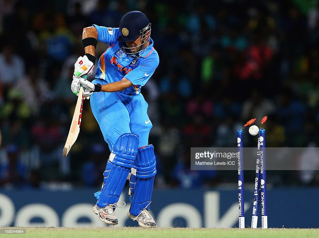 <a gi-track='captionPersonalityLinkClicked' href=/galleries/search?phrase=Gautam+Gambhir&family=editorial&specificpeople=707703 ng-click='$event.stopPropagation()'>Gautam Gambhir</a> of India is bowled by Morne Morkel of South Africa during the ICC World Twenty20 2012 Super Eights Group 2 match between India and South Africa at R. Premadasa Stadium on October 2, 2012 in Colombo, Sri Lanka.