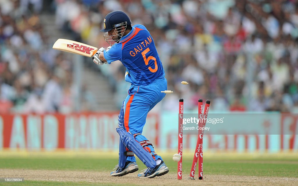 <a gi-track='captionPersonalityLinkClicked' href=/galleries/search?phrase=Gautam+Gambhir&family=editorial&specificpeople=707703 ng-click='$event.stopPropagation()'>Gautam Gambhir</a> of India is bowled by Steven Finn of England during the 5th One Day International between India and England at Eden Gardens on October 25, 2011 in Kolkata, India.