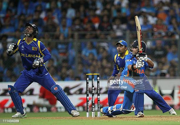 Gautam Gambhir of India paddle sweeps with Kumar Sangakkara of Sri Lanka looking on during the 2011 ICC World Cup Final between India and Sri Lanka...