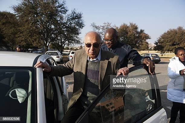 Gauteng Premier David Makhura accompanies Former South African President Nelson Mandela's friend Ahmed Kathrada as Kathrada leaves the polling...