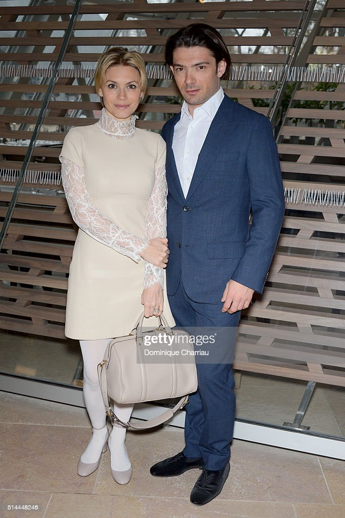 Gautier Capucon (R) and his wife Delphine attend the Louis Vuitton show as part of the Paris Fashion Week Womenswear Fall/Winter 2016/2017 on March 9, 2016 in Paris, France.