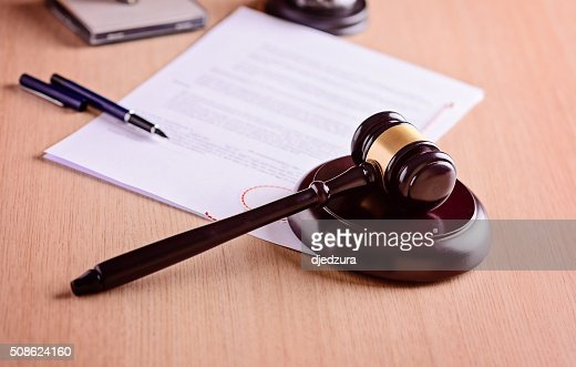 Gavel and judgement on desk. : Stock Photo