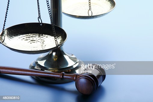 Gavel And Scales Of Justice On A Blue Background : Stock Photo