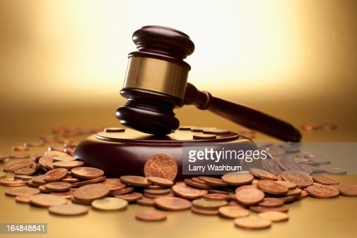 Gavel and sound block surrounded by euro coins