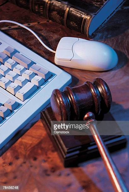 Gavel , computer keyboard and mouse
