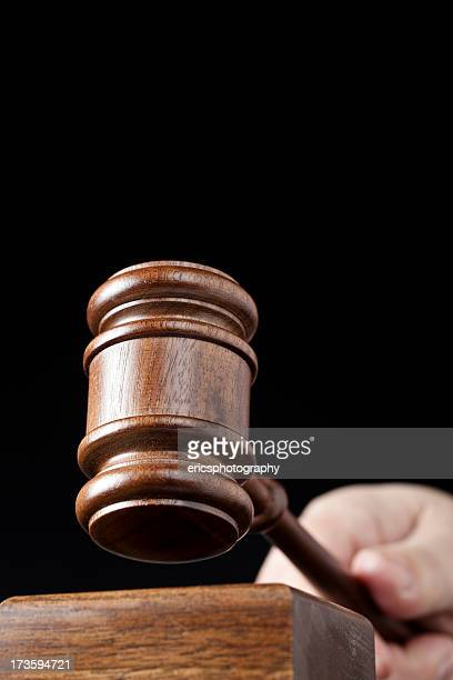 Gavel on black background in hand