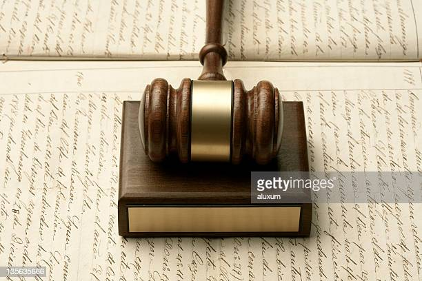 Gavel on old manuscript