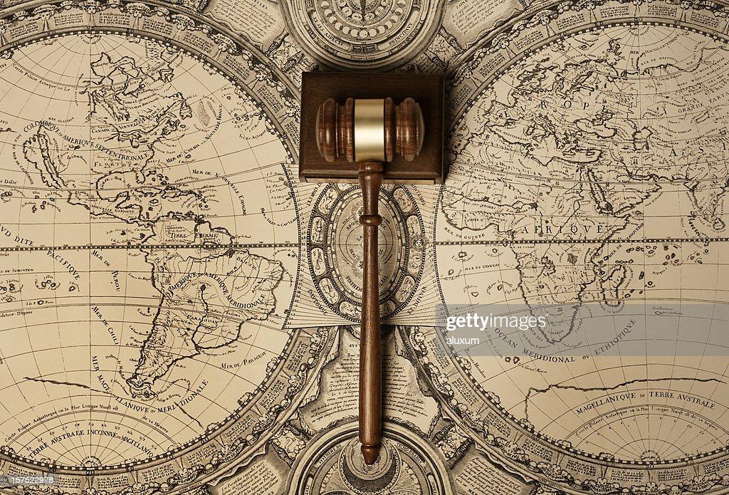 Gavel on old world map : Stock Photo