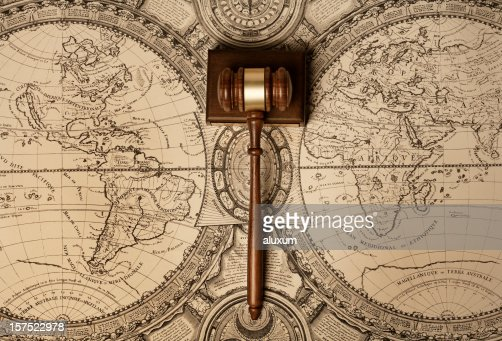 Gavel on old world map