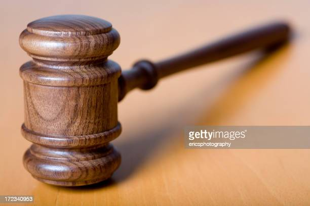 Gavel on wooden table