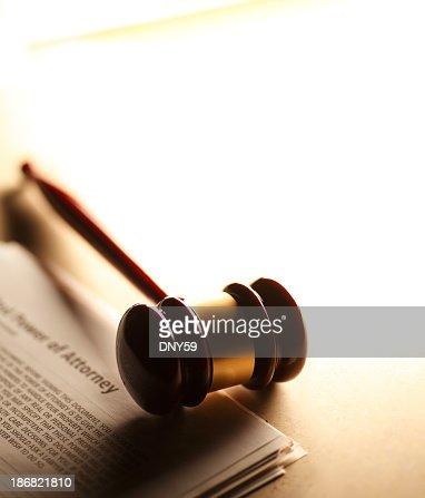 Gavel sitting on power of attorney documents