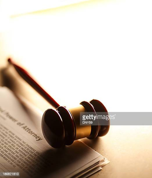 Gavel sitting on power of attorney documents