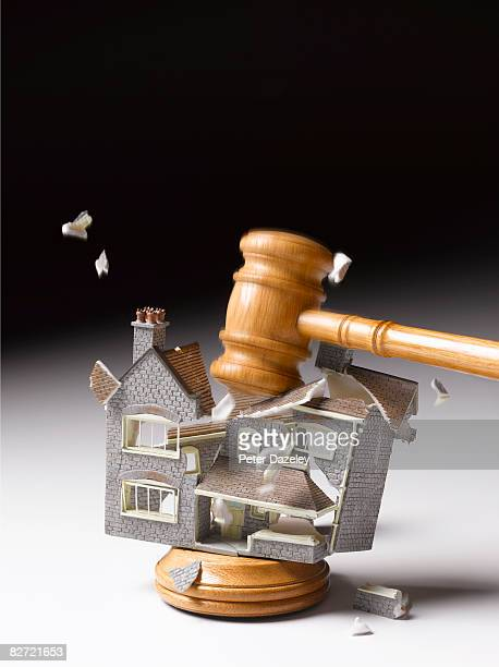 Gavel smashing down on house
