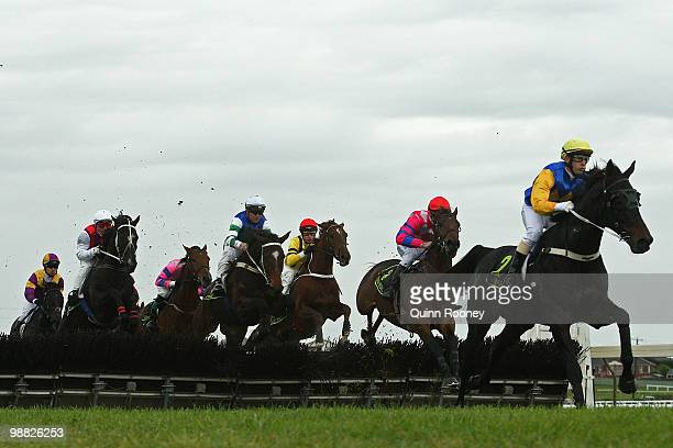 Gavin Bedggood riding Baker Heart leads the field over a hurdle in the Callaghan Motors Maiden Hurdle during day one of the 2010 Warrnambool Racing...