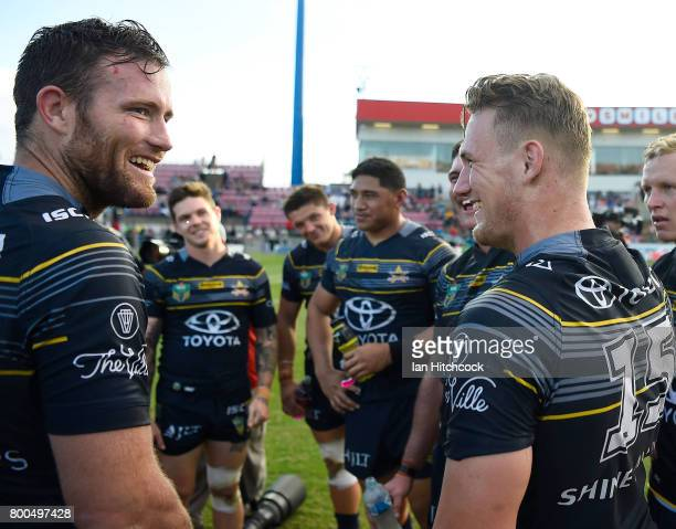Gavin Cooper and Coen Hess of the Cowboys share a laugh after winning the round 16 NRL match between the North Queensland Cowboys and the Penrith...