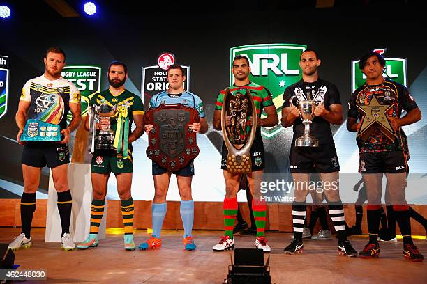Gavin Cooper Cameron Smith Josh Morris Greg Inglis Simon Mannering and Johnathan Thurston hold their respective trophies during the 2015 NRL season...