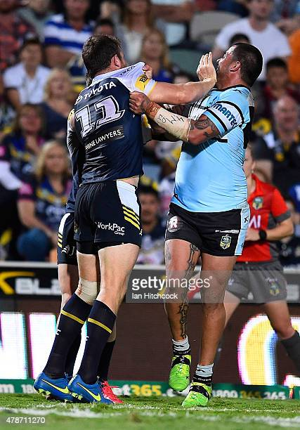 Gavin Cooper of the Cowboys and Andrew Fifita of the Sharks get involved in a melee during the round 16 NRL match between the North Queensland...