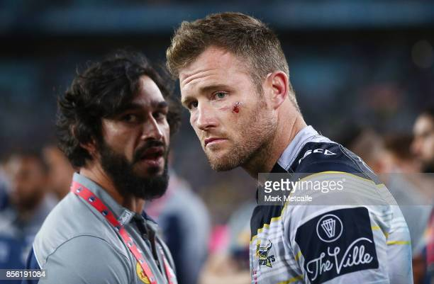 Gavin Cooper of the Cowboys and Jonathan Thurston look dejected after defeat in the 2017 NRL Grand Final match between the Melbourne Storm and the...