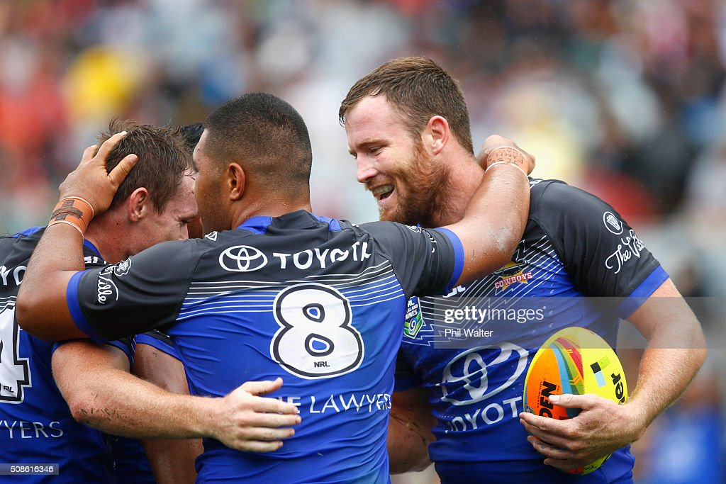 Gavin Cooper of the Cowboys (R) celebrates his try during the 2016 Auckland Nines match between the Cowboys and the Newcastle Knights at Eden Park on February 6, 2016 in Auckland, New Zealand.