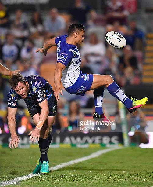 Gavin Cooper of the Cowboys contests a high ball with Sam Perrett of the Bulldogs during the round 20 NRL match between the North Queensland Cowboys...