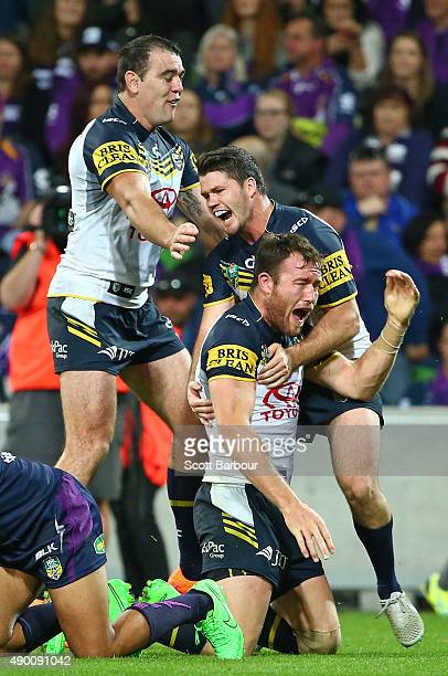 Gavin Cooper of the Cowboys is congratulated by his teammates after scoring a try during the NRL Second Preliminary Final match between the Melbourne...