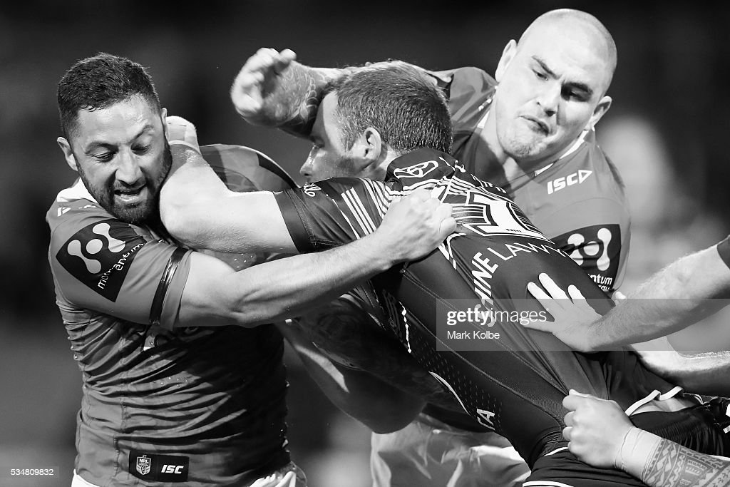Gavin Cooper of the Cowboys is tackled by <a gi-track='captionPersonalityLinkClicked' href=/galleries/search?phrase=Benji+Marshall&family=editorial&specificpeople=215506 ng-click='$event.stopPropagation()'>Benji Marshall</a> and Russell Packer of the Dragons during the round 12 NRL match between the St George Illawarra Dragons and the North Queensland Cowboys at WIN Jubilee Stadium on May 28, 2016 in Wollongong, Australia.