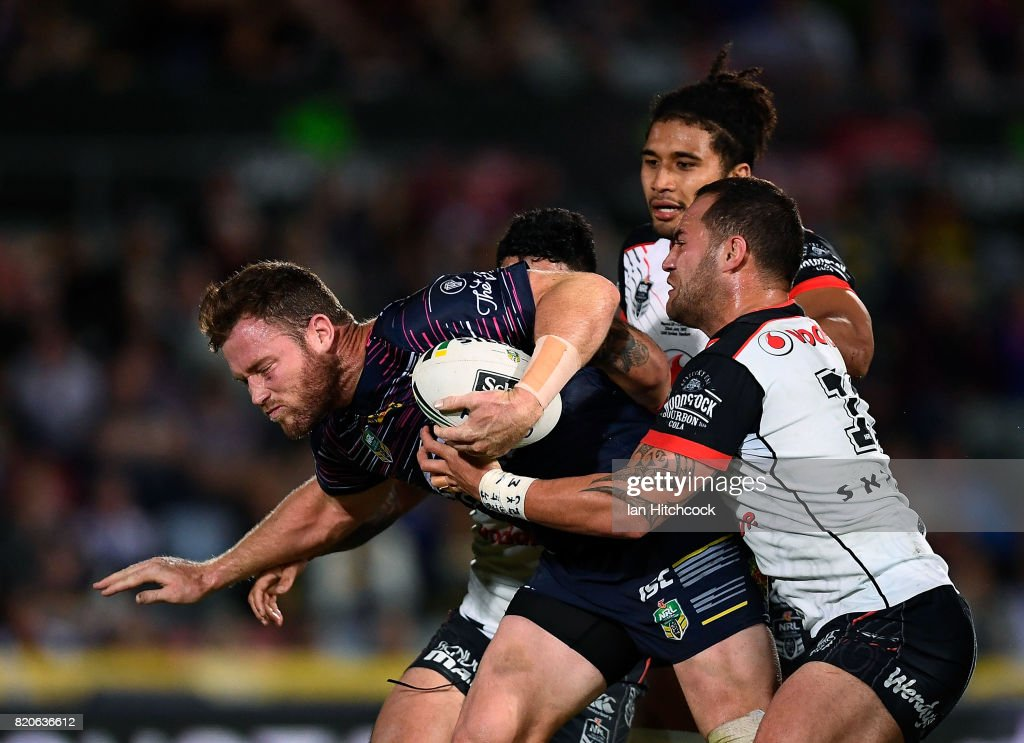 Gavin Cooper of the Cowboys is tackled by Bodene Thompson and Issac Luke of the Warriors during the round 20 NRL match between the North Queensland Cowboys and the New Zealand Warriors at 1300SMILES Stadium on July 22, 2017 in Townsville, Australia.