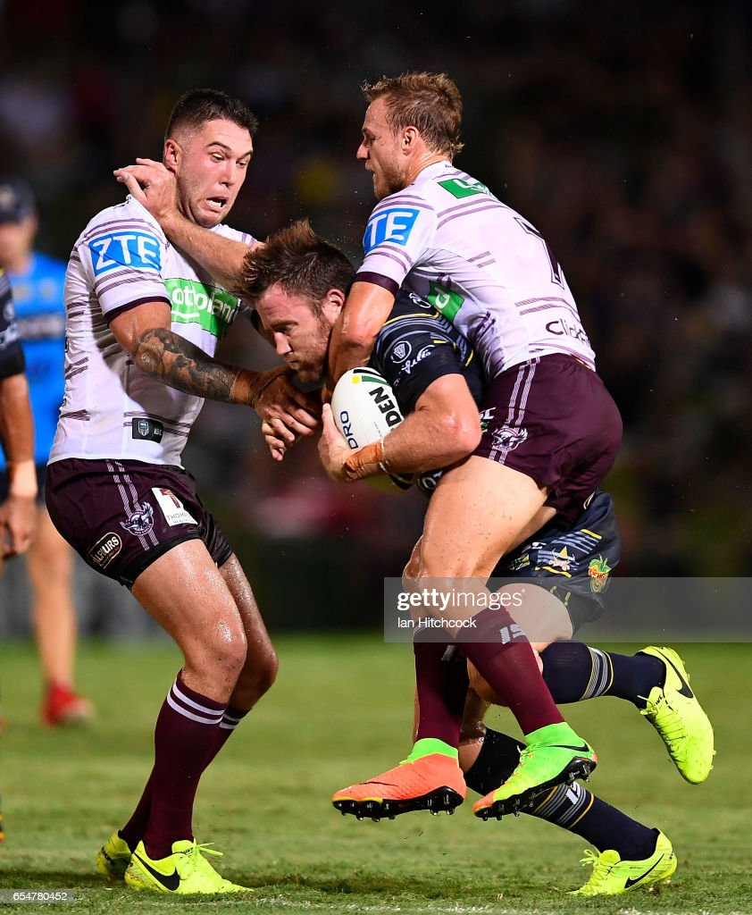 Gavin Cooper of the Cowboys is tackled by Daly Cherry-Evans and Curtis Sironen of the Sea Eagles during the round three NRL match between the North Queensland Cowboys and the Manly Sea Eagles at 1300SMILES Stadium on March 18, 2017 in Townsville, Australia.