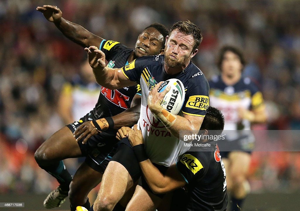 Gavin Cooper of the Cowboys is tackled by James Segeyaro of the Panthers during the round five NRL match between the Penrith Panthers and the North...