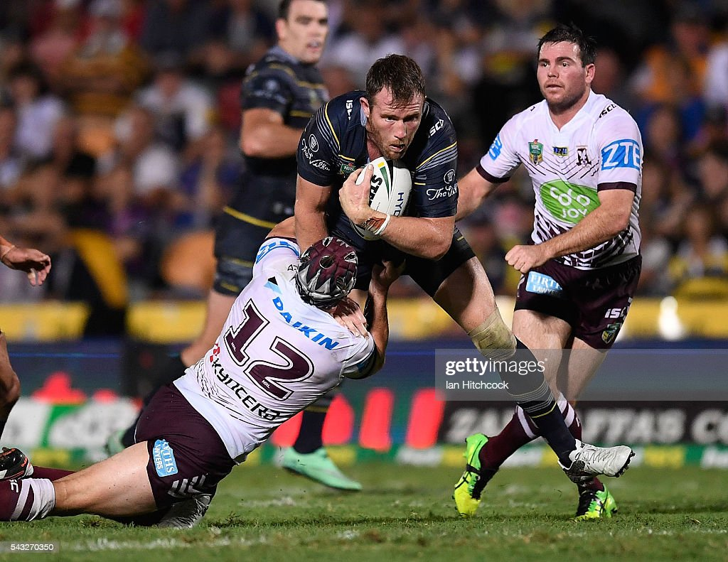 Gavin Cooper of the Cowboys is tackled by Jamie Buhrer of the Sea Eagles during the round 16 NRL match between the North Queensland Cowboys and the Manly Sea Eagles at 1300SMILES Stadium on June 27, 2016 in Townsville, Australia.