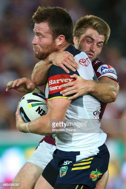 Gavin Cooper of the Cowboys is tackled by Kieran Foran of the Sea Eagles during the round seven NRL match between the ManlyWarringah Sea Eagles and...