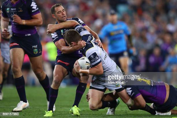 Gavin Cooper of the Cowboys is tackled during the 2017 NRL Grand Final match between the Melbourne Storm and the North Queensland Cowboys at ANZ...
