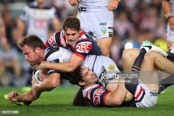 Gavin Cooper of the Cowboys is tackled during the NRL Preliminary Final match between the Sydney Roosters and the North Queensland Cowboys at Allianz...
