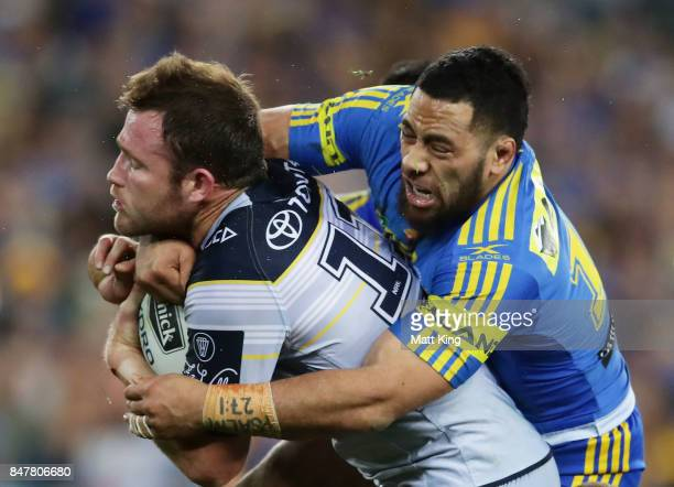 Gavin Cooper of the Cowboys is tackled during the NRL Semi Final match between the Parramatta Eels and the North Queensland Cowboys at ANZ Stadium on...