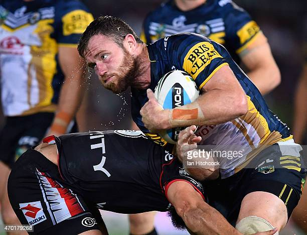 Gavin Cooper of the Cowboys is tackled during the round seven NRL match between the North Queensland Cowboys and the New Zealand Warriors at...