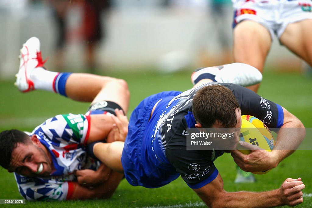 Gavin Cooper of the Cowboys scores a try during the 2016 Auckland Nines match between the Cowboys and the Newcastle Knights at Eden Park on February 6, 2016 in Auckland, New Zealand.