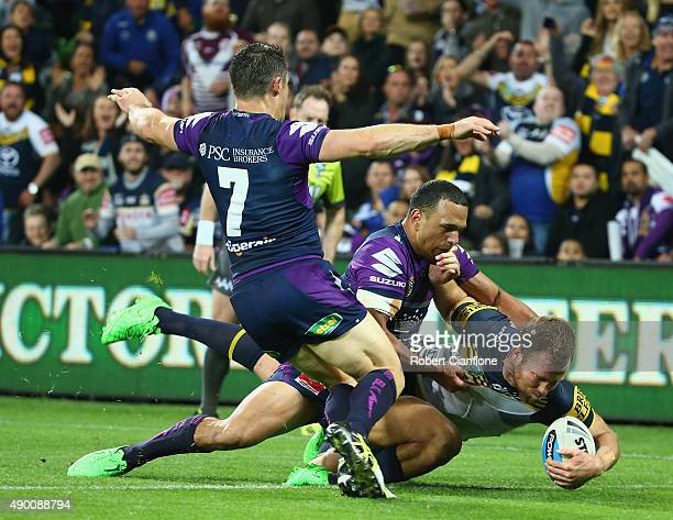 Gavin Cooper of the Cowboys scores a try during the NRL Second Preliminary Final match between the Melbourne Storm and the North Queensland Cowboys...