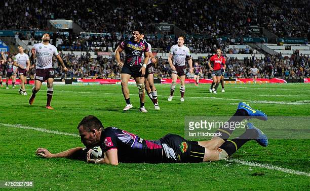 Gavin Cooper of the Cowboys scores the winning try during the round 12 NRL match between the North Queensland Cowboys and the Manly Sea Eagles at...