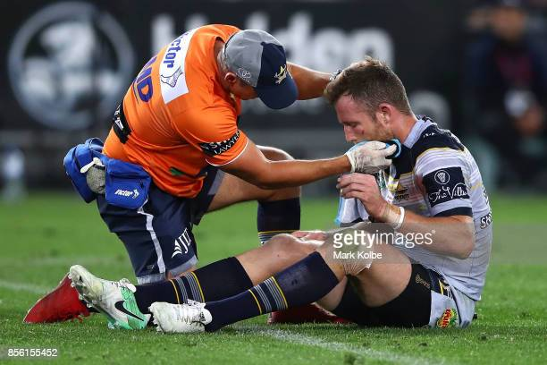 Gavin Cooper of the Cowboys seeks medical attention during the 2017 NRL Grand Final match between the Melbourne Storm and the North Queensland...