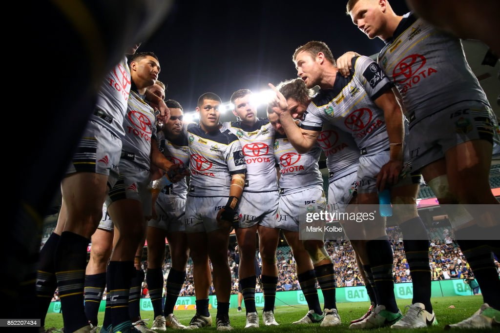 Gavin Cooper of the Cowboys speaks to the his team mates as the Cowboys celebrate victory during the NRL Preliminary Final match between the Sydney Roosters and the North Queensland Cowboys at Allianz Stadium on September 23, 2017 in Sydney, Australia.