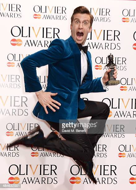 Gavin Creel winner of the Best Actor in a Musical award for 'The Book Of Mormon' poses in the press room at the Laurence Olivier Awards at The Royal...