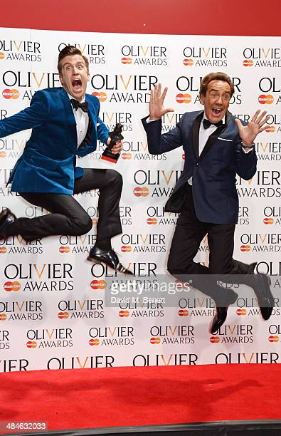 Gavin Creel winner of the Best Actor in a Musical award for 'The Book Of Mormon' and Robert Lindsay jump in the press room at the Laurence Olivier...