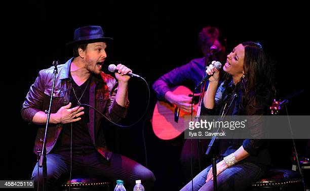 Gavin DeGraw and Sara Evans perform at CMA Theater at the Country Music Hall of Fame and Museum on November 4 2014 in Nashville Tennessee