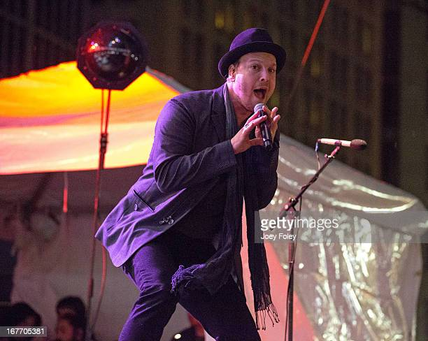 Gavin DeGraw performs onstage in the rain during the 2013 500 Festival REV Your Engines Concert at Monument Circle on April 27 2013 in Indianapolis...