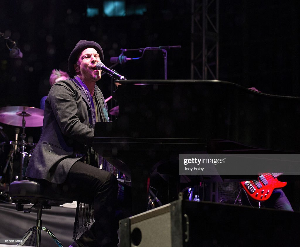 <a gi-track='captionPersonalityLinkClicked' href=/galleries/search?phrase=Gavin+DeGraw&family=editorial&specificpeople=203282 ng-click='$event.stopPropagation()'>Gavin DeGraw</a> performs onstage in the rain during the 2013 500 Festival REV Your Engines Concert at Monument Circle on April 27, 2013 in Indianapolis, Indiana.